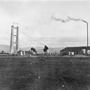 The Tane Hemp Co flax mill and the 20 metre-high chimney. The southern tower of the bridge is on the left.