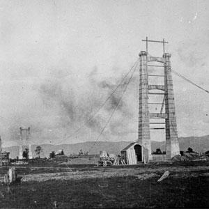Construction of the  154.4 metre-long Opiki suspension bridge. (Circa 1917).