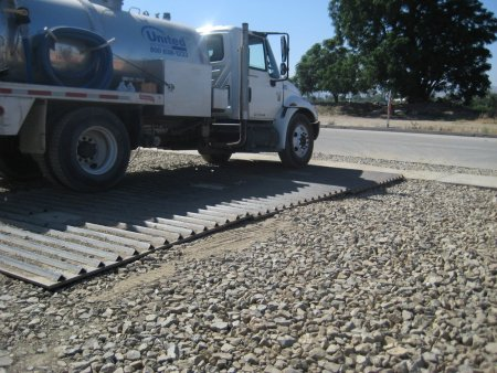 Rattle Track shakes the tires, removing dirt, mud, and other debris from the tires of your vehicles as you exit the jobsite.