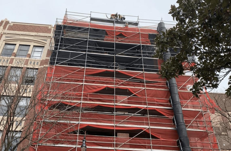 installing hoist on the scaffold