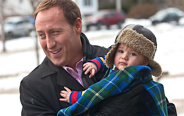 Peter MacKay holds his son Kian in Halifax