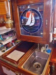 Our galley…a sink, a tiny counter, and a beautiful stained glass cabinet