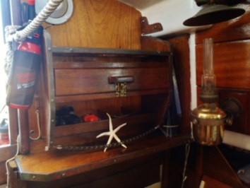 Just port of the companionway, above the stove/nav table