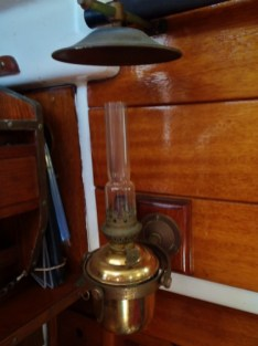 A nice old brass oil lamp