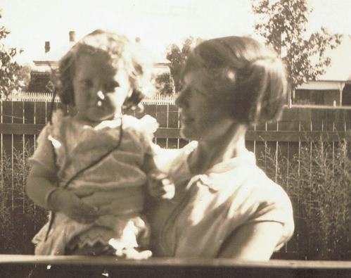 The author's great aunt Edna Moore with her niece Valda Pacholli wearing a crystal set at the Moore family home in Moore Street, circa 1930