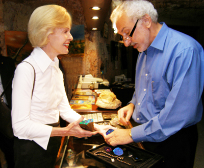 Her Excellency Ms Quentin Bryce AC admiring an opal collection with Mr Yanni Athanasiadis at Umoona Opal Mine in Coober Pedy