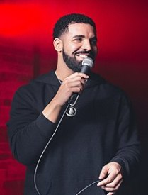"This was a difficult decision, given that Ariana Grande's ""Thank U, Next"" made Youtube history and Cardi B was found on the radio almost every month, but Drake's Scorpion had listeners nearly risking their lives to become internet sensations with ""In My Feelings."" With multiple number one tracks and keeping his use of additional guests to a minimum, Drake was able to conquer a 25 song project where each song made it nearly impossible to stop listening, making 2018 Drake's year. - Taylor Marron Drake dominated the billboards this year with every single he dropped, which replaced his previous #1 record. Scorpion may have been a lackluster album to some, but you can't hide the fact that it has over a billion streams. Drake broke many records this year and was named the highest selling artist in America. Like Drake said ""How you let me run it down, I'm not even from around here"" - Quenton Redding 2018 was a year that was ran by Drake with big songs such as ""In My Feelings,"" ""God's Plan,"" and ""Nice for What."" In addition to having his own big solo songs, Drizzy dominated the year with big features on artists' songs like Lil baby, Bloc Boy JB, and Migos. Not only did Drake have an impactful year as far as music production, but his touring numbers were insane. Aubrey and the Three Amigos Tour brought in a ridiculous 79 million dollars. The year was so crazy that Aubrey announced publicly that he would be taking time away from music. - Nsikan Inyang"