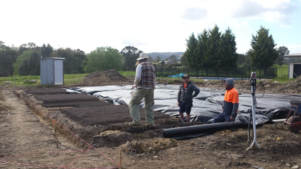 Labourers helping out for the slab preparation, looks like Matt is playing boss
