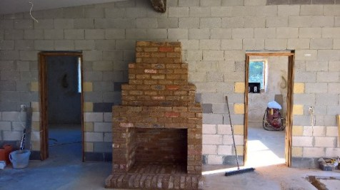 Brick masonry work complete for the open fireplace