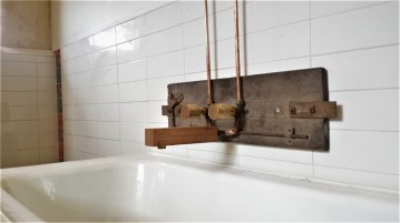 Bath spout and taps with exposed copper pipes