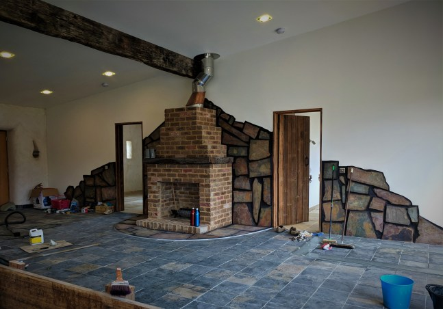 Main living area with unsealed slate tiles