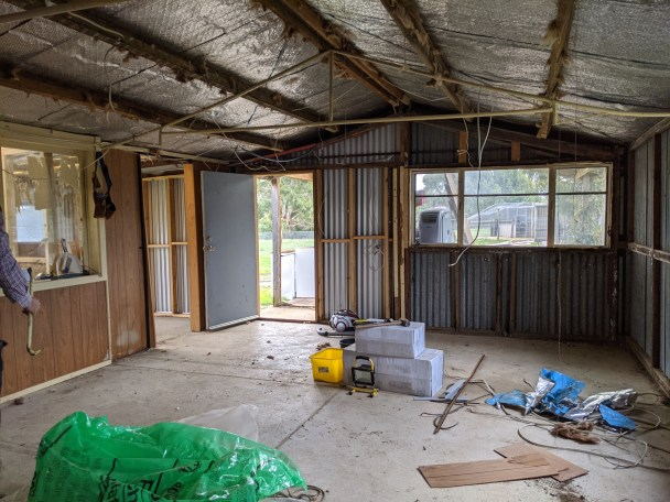 Main living area with partition wall still intact