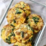 "The cooked muffin egg cups in a glass container with the words ""Whole30, Paleo Chorizo, Potato & Kale Frittatas"" for Pinterest"