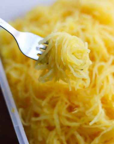 A fork holding up cooked, tender spaghetti squash
