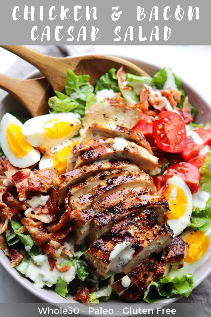 """Graphic for Pinterest with a close up shot of the finished dish with the text """"Chicken and Bacon Caesar salad, Whole30, Paleo, Gluten Free."""""""