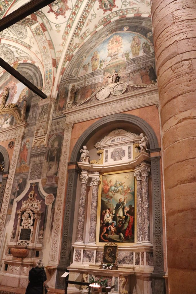 A large painted mural inside a giant cathedral