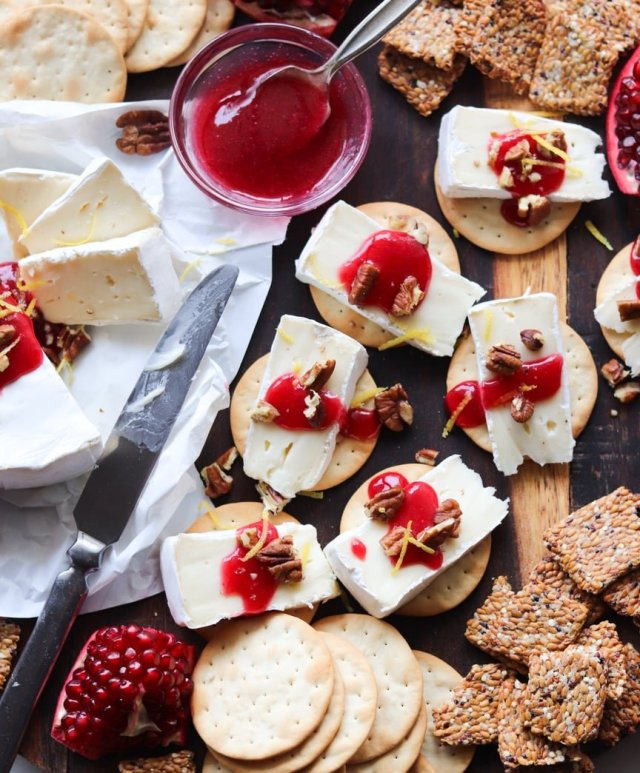 Close up of the assembled cranberry horseradish brie bites on the cheeseboard.