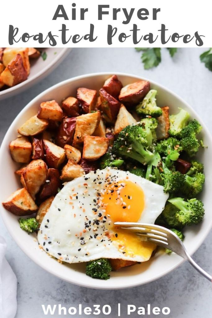 "Top down of cooked red potatoes with a fried egg and broccoli with the words ""Air Fryer Roasted Potatoes"" for Pinterest"