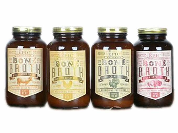Four brown glass jars of Epic bone broth flavors