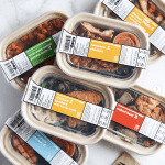Boxes of delivered Whole30 Approved and Keto snap kitchen boxes