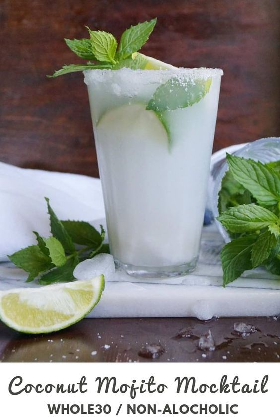 "Pinterest graphic with the text ""coconut mojito mocktail, whole30/non-alcoholic"" and an image of the finished drink in a tall glass, garnished with lime slices and fresh mint."