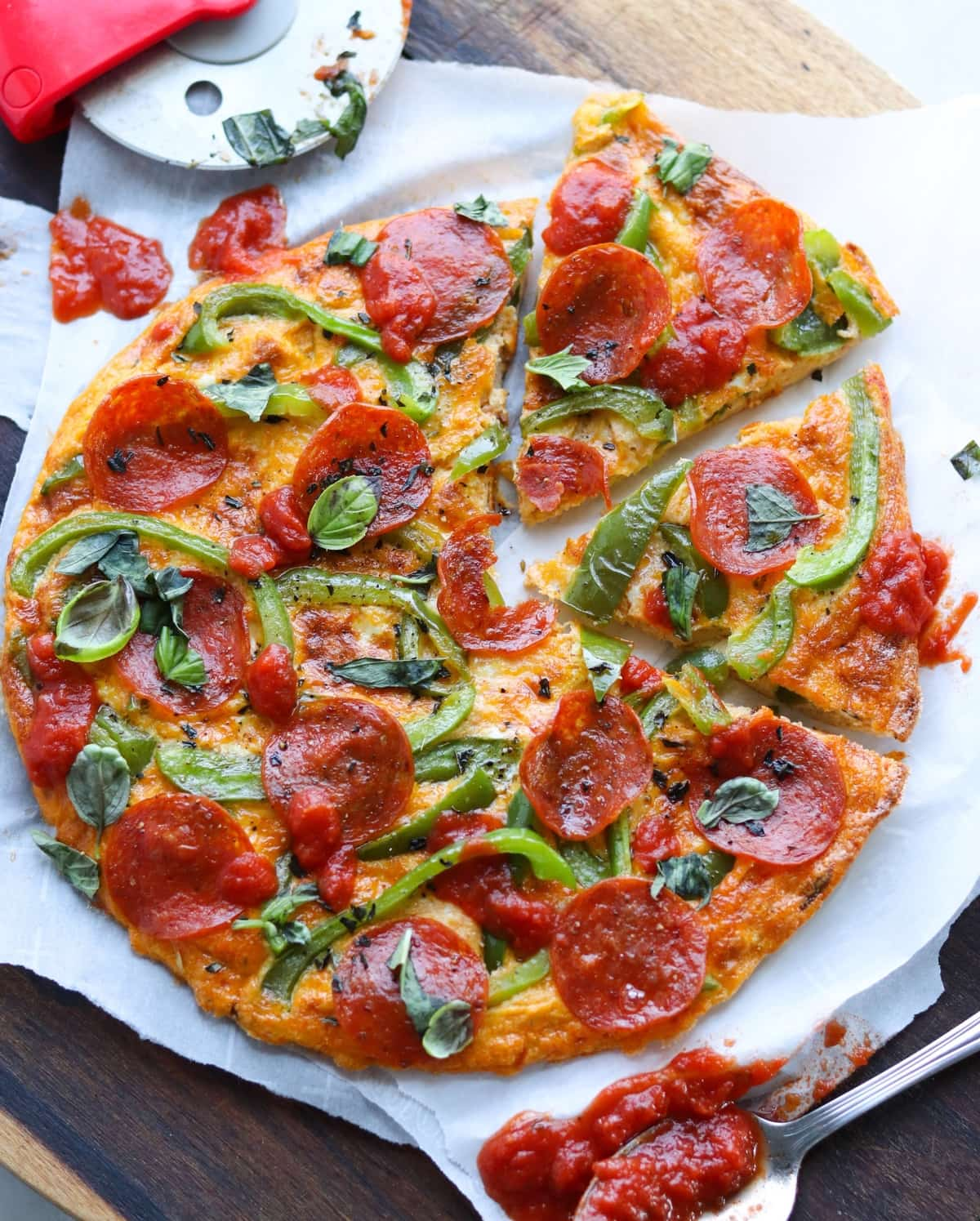 The finished and sliced pepperoni pizza frittata on a cutting board.