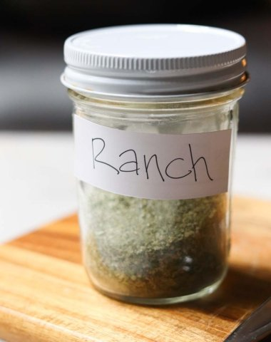 "A small mason jar filled with ranch seasoning labeled ""Ranch"""