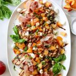 "Pinterest Graphic with a close up of the finished dish and the words ""Stone Fruit Caprese Grilled Chicken"""