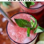 """Close up top down of a filled glass garnished with lime and fresh mint, with the text """"Non-Alcoholic, Whole30 Watermelon Mocktail"""""""