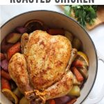 "Top down of the cooked chicken in a dutch oven with the words ""Dutch Oven Roasted Chicken, Whole30, Paleo, GF"" for Pinterest"