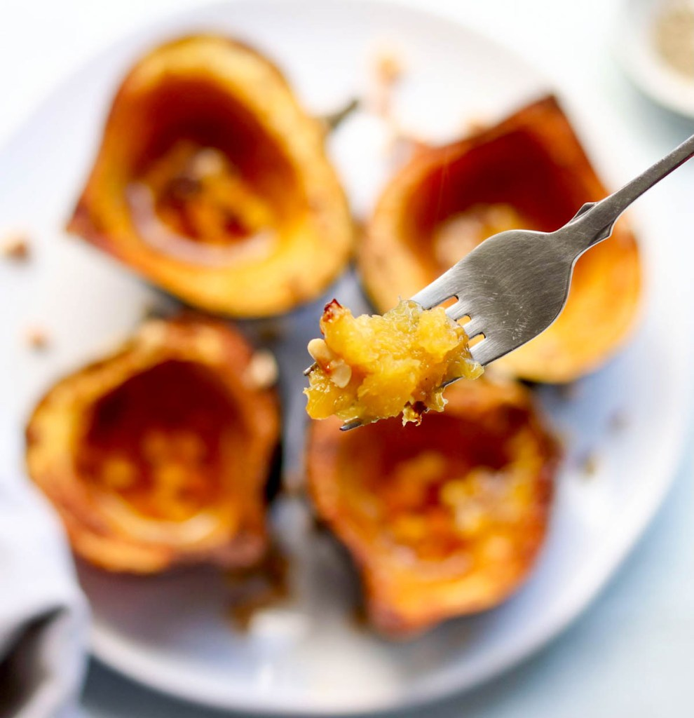 Close up of one bite of acorn squash on a fork.