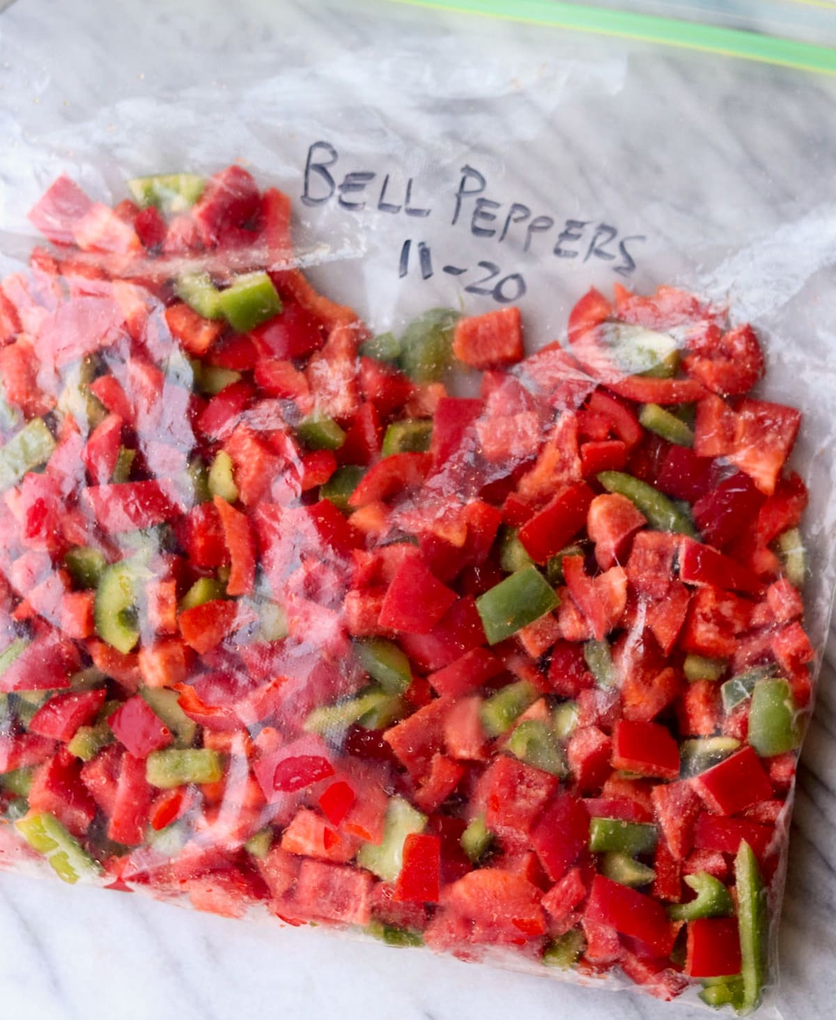 Close up of a zip lock bag filled with diced bell peppers.