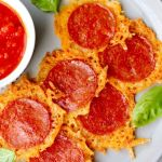 "Close up of the finished dish with the words ""Keto Pepperoni and Cheese Crisps"" for Pinterest."