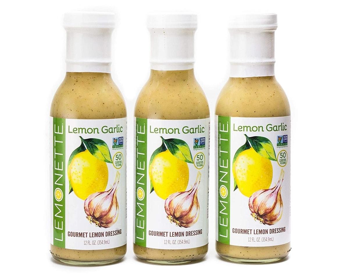 Three bottles of Lemonette Lemon Garlic dressing.
