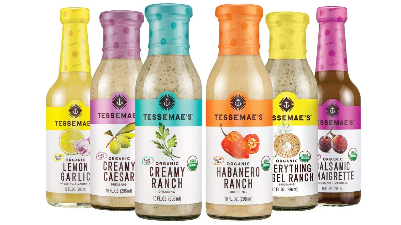 Six Tessemae's Salad Dressings lined up.