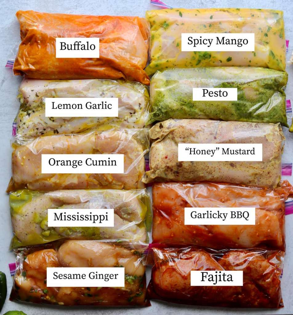 Tens labeled bags of marinating chicken in different healthy marinades.