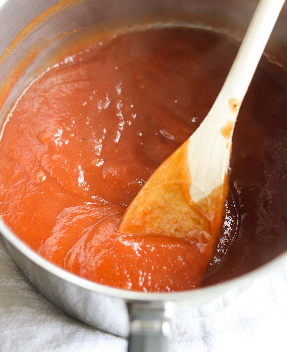Close up of the bbq sauce simmering in a sauce pan.