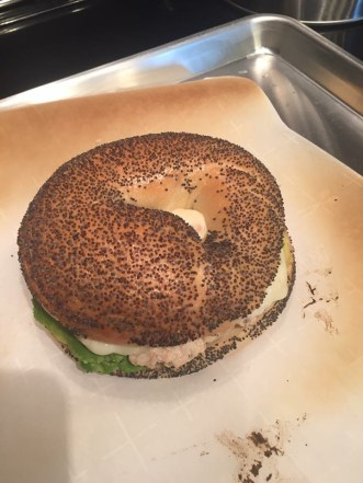 Avocado chicken salad on a toasted bagel.