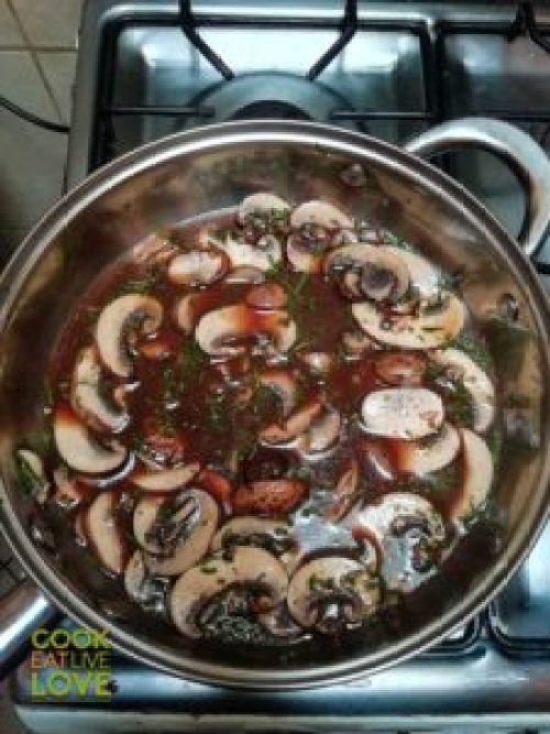 Making Red Wine Miso Mushroom Sauce - Add wine and broth