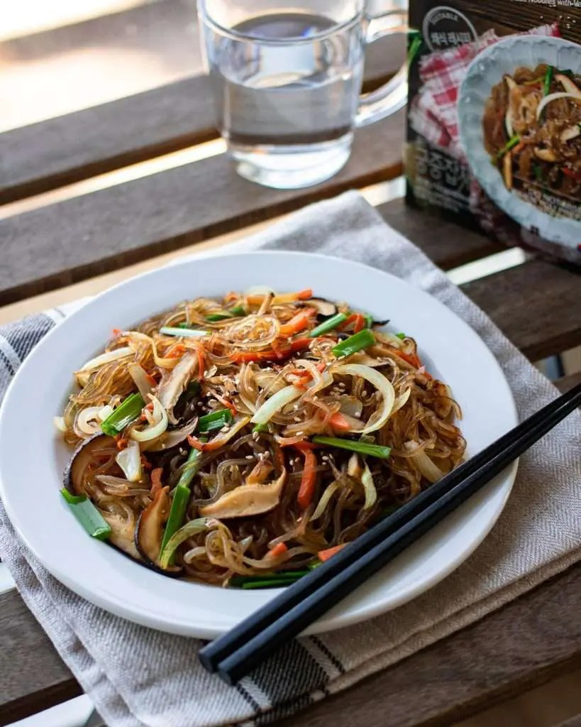 japchae korean glass noodles served on a plate
