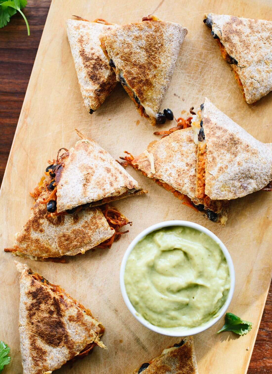 Amazing sweet potato black bean quesadillas with creamy avocado salsa verde (perfect for busy weeknights!) - cookieandkate.com