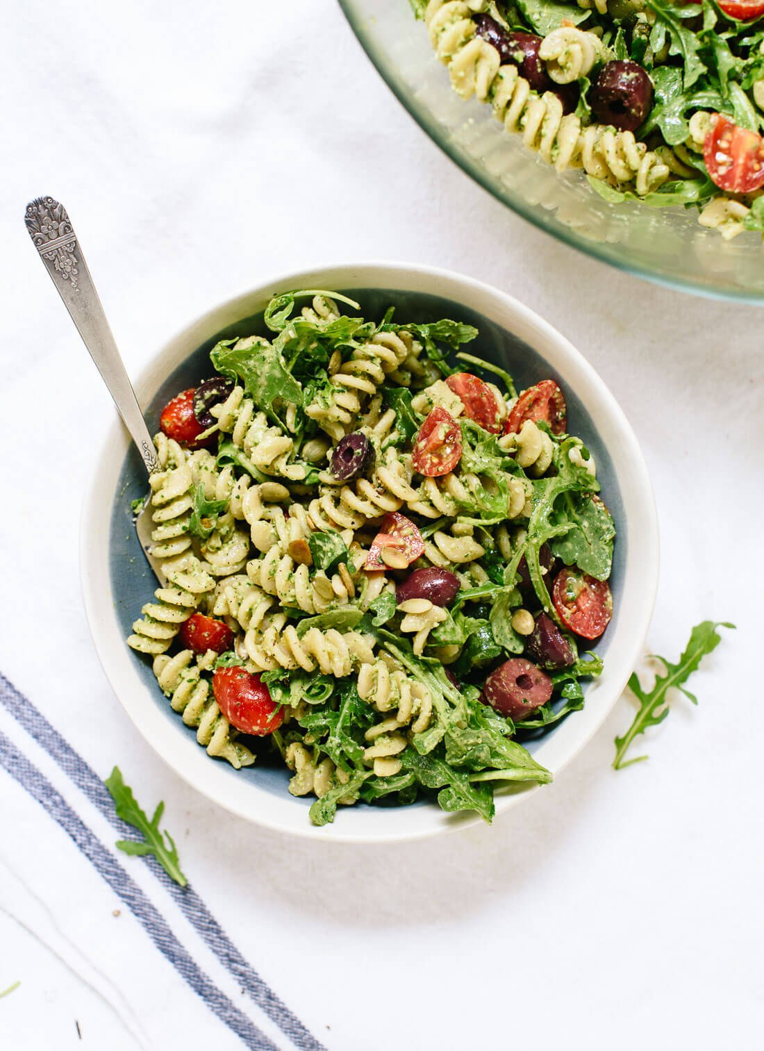 This pesto pasta salad recipe is bursting with fresh flavor! It's light, healthy and easy to make. Perfect for picnics and potlucks! cookieandkate.com