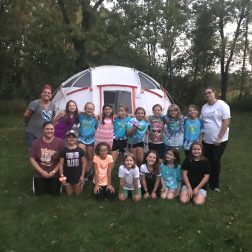 Girl Scouts in their community