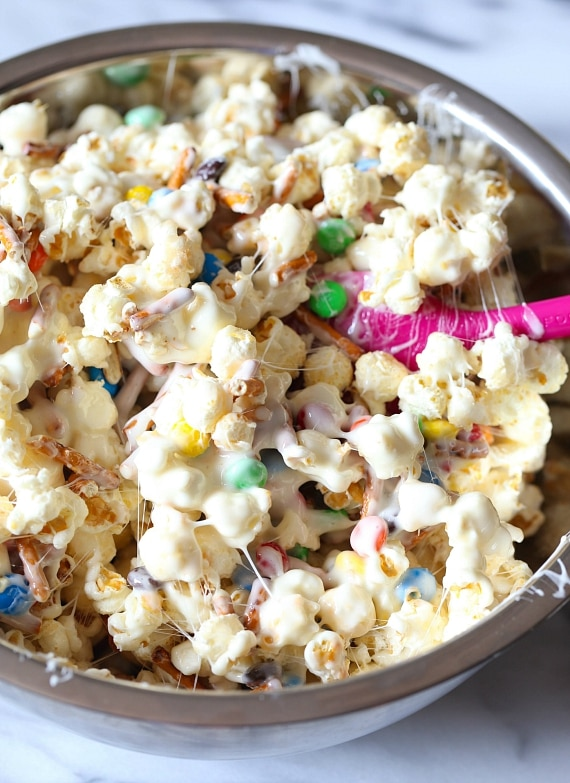This Popcorn Cake is chewy, gooey, sweet and totally over the top! It's such a simple and fun alternative for a party cake!