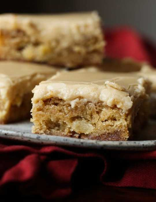 Apple Toffee Blondies are buttery blondoes with tart apple pieces and sweet toffee bits! It's topped with a brown sugar frosting!