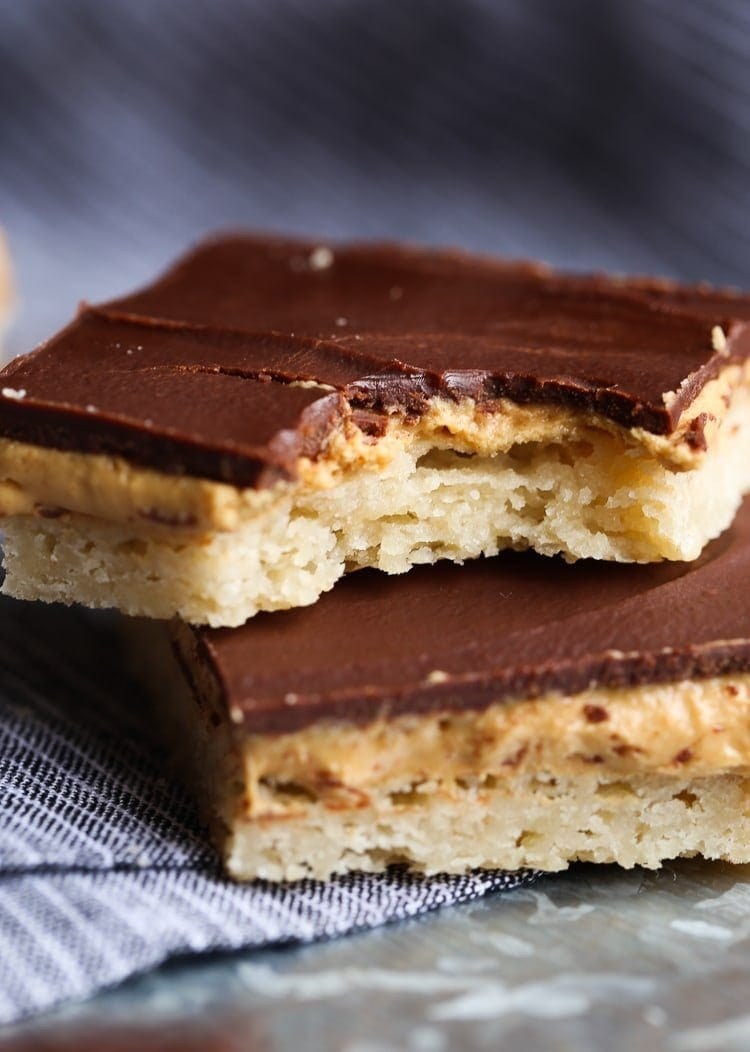 Tagalong Bars are a homemade version of the classic Girl Scout Cookie...a buttery shortbread crust, with a sweet, creamy peanut butter filling, topped with rich chocolate. A fun twist on the original!