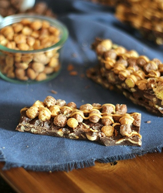 Peanut Butter Cup Candy Bars ~ A cross between a candy bar and bark, loaded with peanut butter cups, peanuts and Reese's Puffs Cereal!