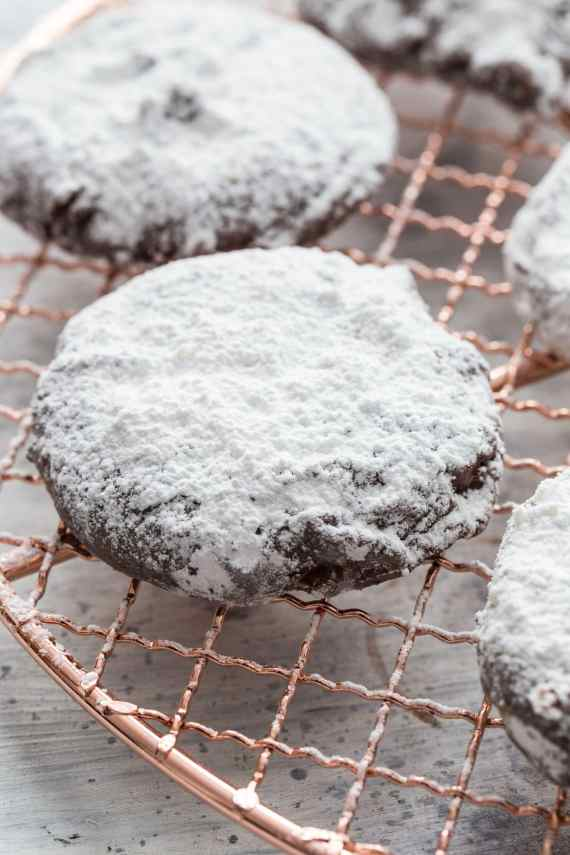 Puppy Chow Cookies! These are a delicious peanut butter cookie coated in chocolate and powdered sugar! The cookie version of the popular snack mix!