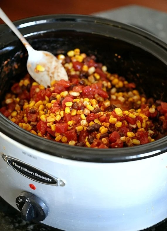 Slow Cooker Fiesta Chicken. Easy, low fat and can be used for so many dinners! | www.cookiesandcups.com