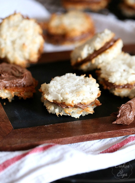 Coconut Macaroon Cookie Sandwiches ~ Two coconut macaroons sandwiched together with a creamy chocolate filling!